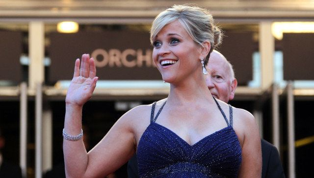 US actress Reese Witherspoon waves as she arrives for the screening of the film 'Mud' presented in competition at the 65th Ca