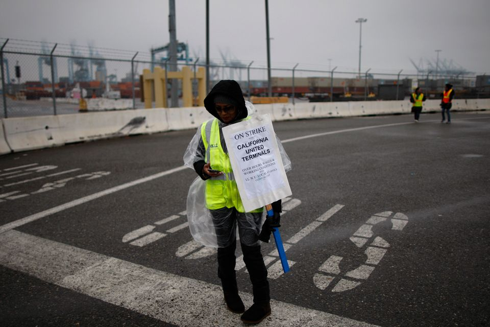 LONG BEACH, CA - NOVEMBER 29:  Members of International Longshore and Warehouse Union Local 63 Office Clerical Unit walk a pi