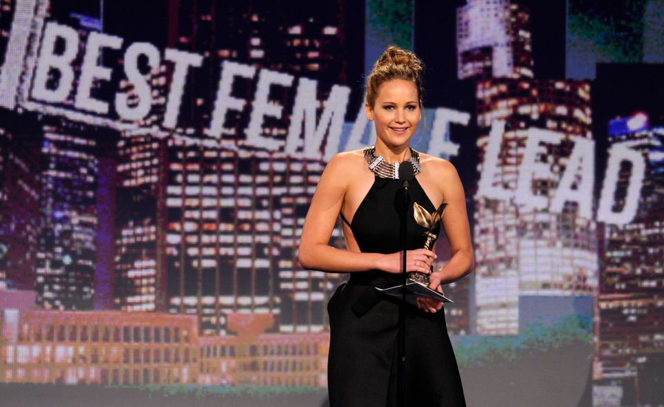 """Actress Jennifer Lawrence accepts the award for best female lead for """"Silver Linings Playbook"""" at the Independent Spirit Awar"""
