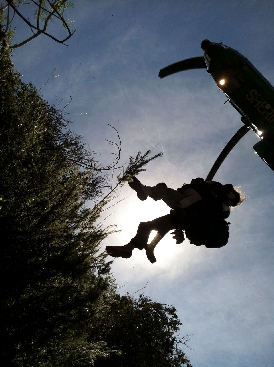 This photo provided by Los Angeles County Search and Rescue Reserve Deputy Doug Cramoline shows the helicopter rescue of Kynd