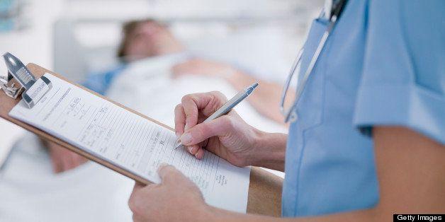 Nurse tending patient in intensive care