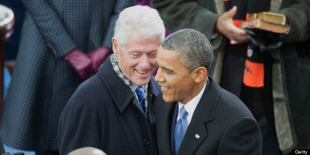 UNITED STATES - JANUARY 21: Former President Bill Clinton greets U.S. President Barack Obama at the inauguration for his seco