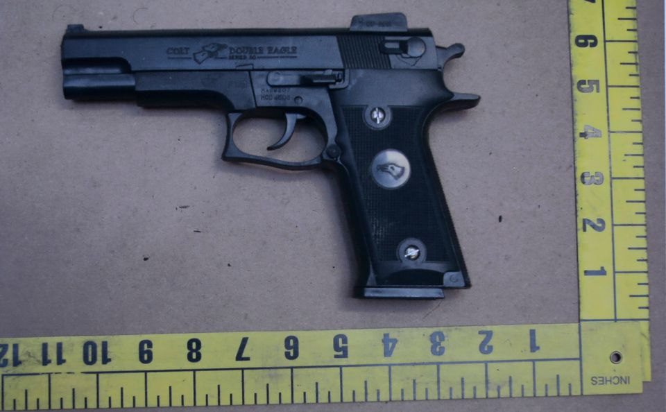 An evidence photo showing a Colt pistol is among several new evidence photos of the June 9 shooting rampage by John Zawahri t