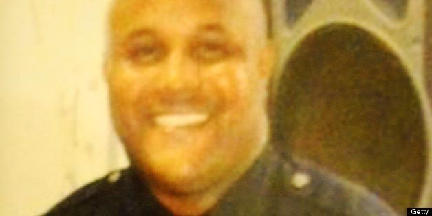 Fired Los Angeles Police Department (LAPD) officer Christopher Dorner is seen in an undated photo displayed at a press conference regarding the manhunt for Dorner, at LADP headquarters in Los Angeles February 7, 2013. Los Angeles police launched a full-scale manhunt for Dorner, a dismissed officer believed to have killed three people including another cop. Christopher Jordan Dorner had posted a chilling online warning about 'terminating' the life of a collegue he blamed for his dismissal, and threatening other police and their families. AFP PHOTOS / ROBYN BECK (Photo credit should read ROBYN BECK/AFP/Getty Images)