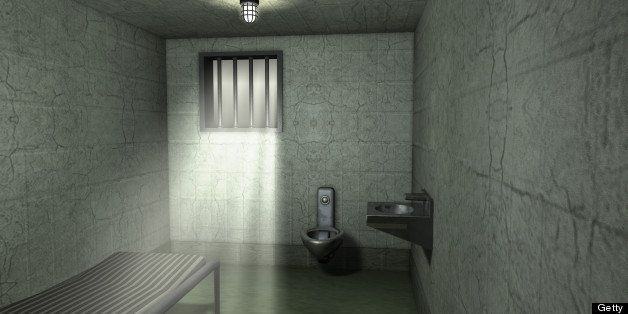 An empty jail cell in a traditional prison