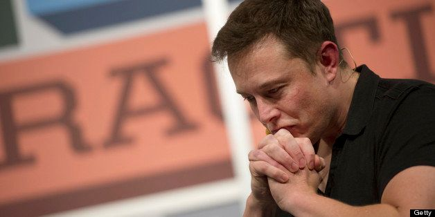 Elon Musk, chief executive officer of Tesla Motors Inc. and Space Exploration Technologies Inc., pauses while speaking during