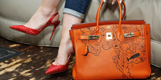 NEW YORK, NY - MAY 14:  Comes With Baggage Founder Lori Levine shows off her one-of-a-kind orange Hermès Birkin at the Comes
