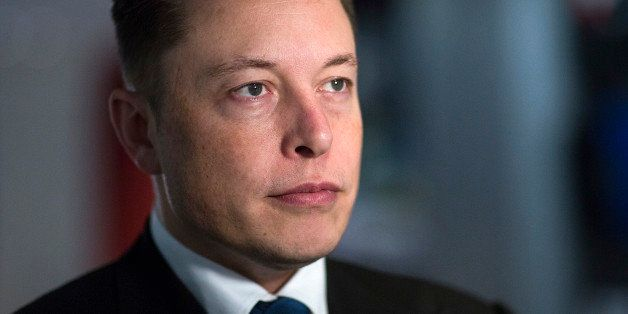 Elon Musk, billionaire, co-founder and chief executive officer of Tesla Motors Inc., poses for a photograph inside the Tesla