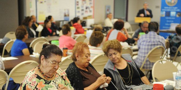Women knit as they attend  a Senior Information & Resource Fair in South Gate, California September 10, 2013 . The event incl