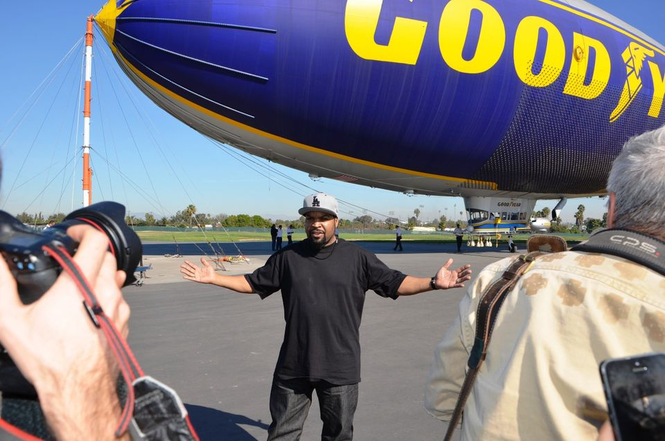 Ice Cube poses in front of the Goodyear Blimp.