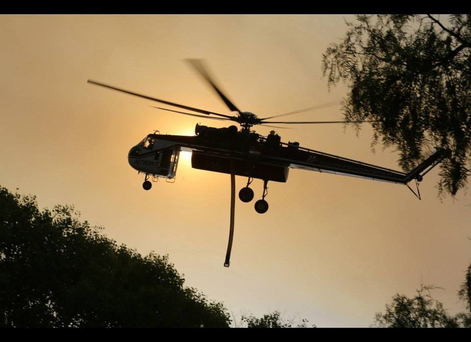 U.S. Marines and fire crew on Marine Corps Base Camp Pendleton, Calif., respond to wildfires ablaze in southern California Ma