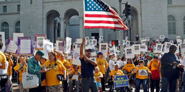 Demonstrators take part in a march and rally sponsored the Service Employees International Union in downtown Los Angeles Tues