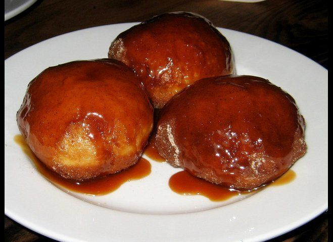 """The Gastronomer says: """"The trio of poofed-out orbs are served hot from the fryer and drenched in a gooey caramel sauce. The d"""