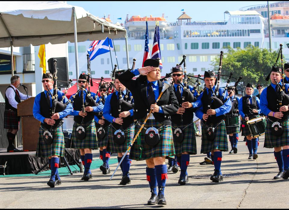 Scottish pipers salute the master of ceremonies during the Parade of Clans at ScotsFestival at the Queen Mary in Long Beach,