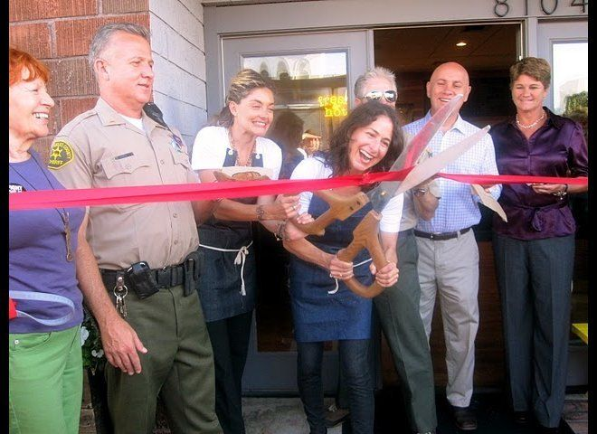 Lucas and Truman, flanked by Los Angeles County sheriffs, man-handle a giant