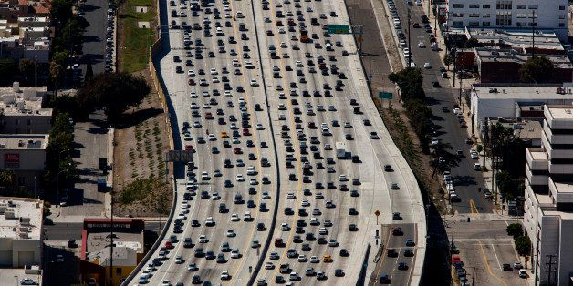Vehicles sit in rush hour traffic on the Interstate 405 freeway in this aerial photograph taken over the Westwood neighborhoo
