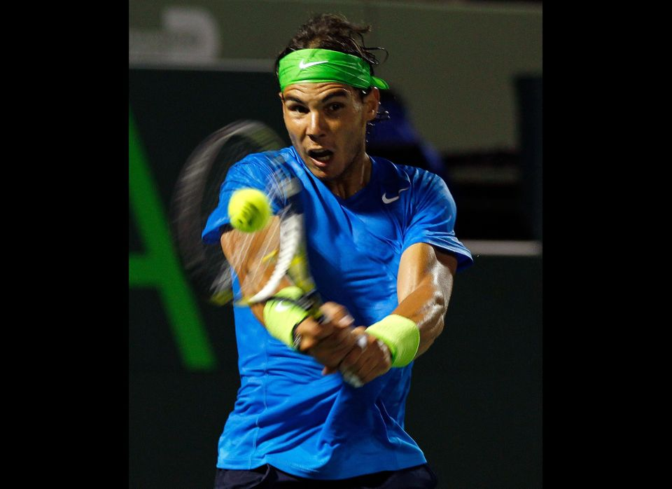 KEY BISCAYNE, FL - MARCH 28:  Rafael Nadal of Spain in action against Jo-Wilfried Tsonga of France during Day 10 of the Sony