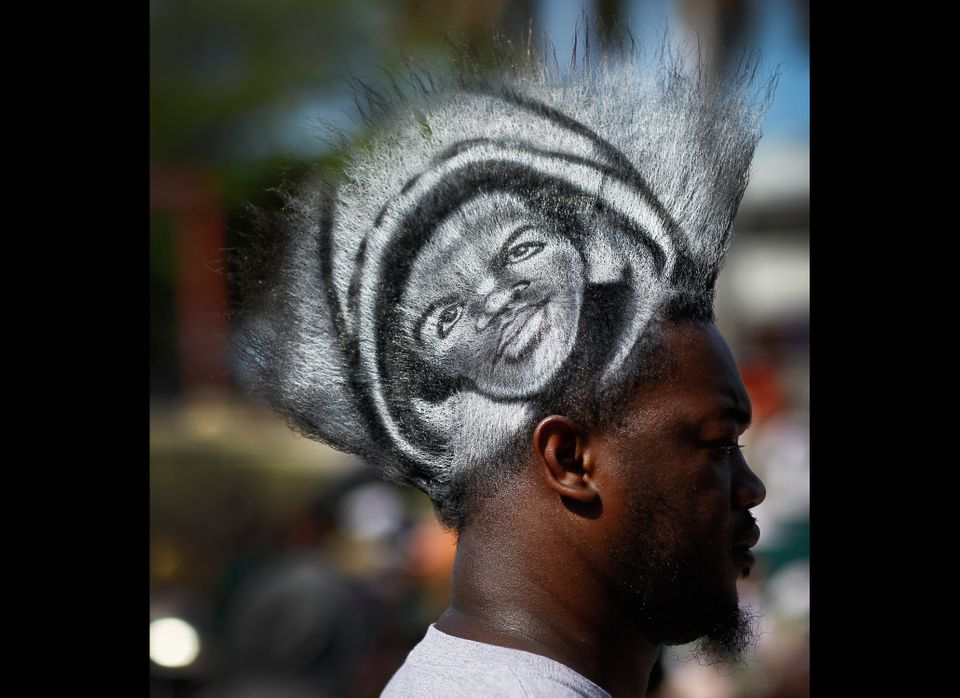 MIAMI, FL - APRIL 01: Mohawk Gaz wears a picture of Trayvon Martin in his hair as he and other supporters gather for a rally