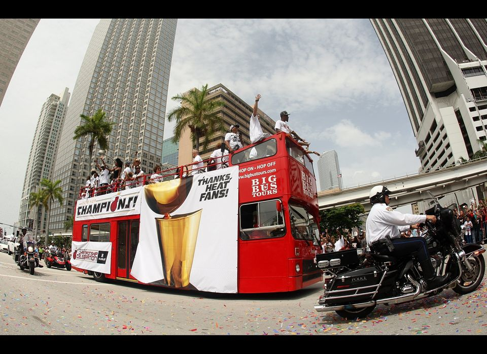 MIAMI, FL - JUNE 25:  Players of the Miami Heat wave to fans during a celebration parade for the 2012 NBA Champion Miami Heat