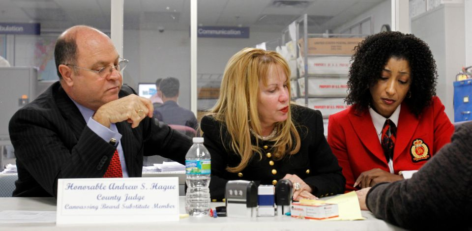 Canvassing Board members, county judges Andrew S. Hague, left, Shelley J. Kravitz, center and Miami-Dade Supervisor of Electi