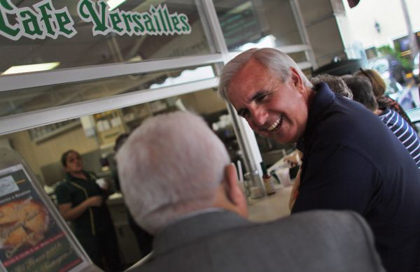 Miami-Dade Mayor Carlos Gimenez (R) saw the long lines forming across his county and heard the complaints of his constituents