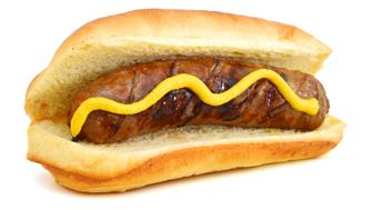 Grilled Bratwurst with mustard on bun. Isolated.