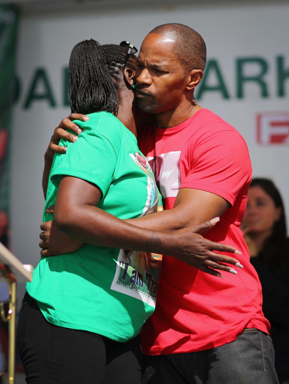 MIAMI, FL - FEBRUARY 09:  Actor Jamie Foxx hugs Sybrina Fulton during the 'March for Peace' at Ives Estate Park in honor of h