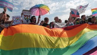 ST  PETERSBURG, RUSSIA - 2017/08/12: Participants hold a rainbow flag commonly known as the LGBT pride flag during the Gay Pride demonstration in Field of Mars. Several dozens of people came to Field of Mars in St. Petersburg for participation in VIII St. Petersburg LGBT Pride. (Photo by Igor Russak/SOPA Images/LightRocket via Getty Images)