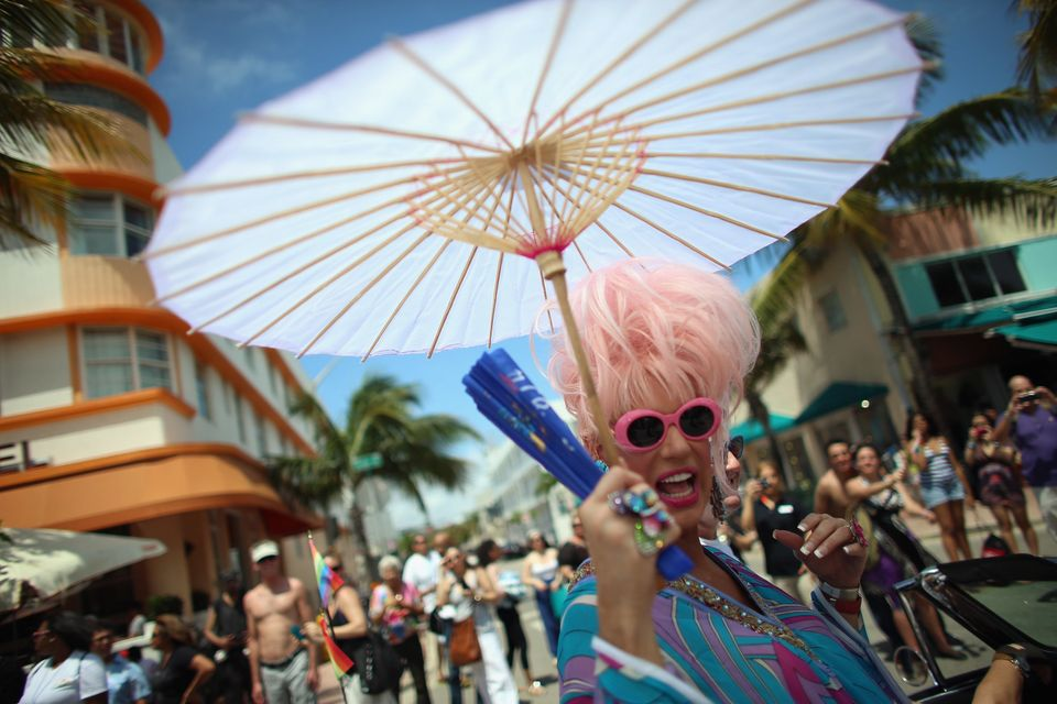 MIAMI BEACH, FL - APRIL 14:  People participate in the Fifth annual Miami Beach Gay Pride Parade along Ocean Drive on April 1