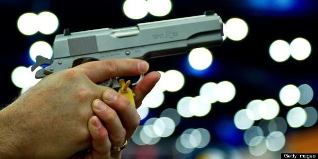 A convention goer handles a Ruger 1911 model semi-automatic pistol during the142nd annual National Rifle Association(NRA) con