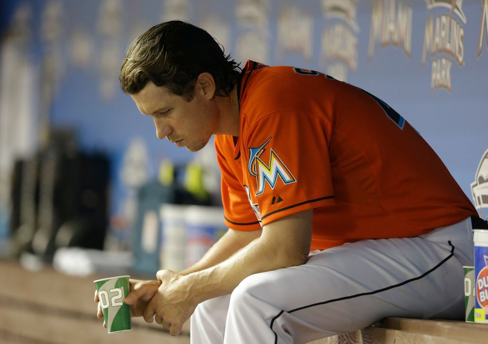 Miami Marlins starting pitcher Kevin Slowey sits in the dugout in the fifth inning during a baseball game against the New Yor
