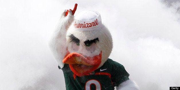 MIAMI GARDENS, FL - APRIL 13: The Miami Hurricanes mascot 'Sebastian the ibis' leads the players through the smoke for their