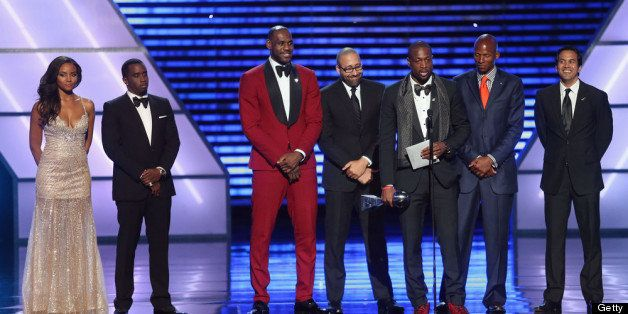 LOS ANGELES, CA - JULY 17:  (L-R) Sean 'Diddy' Combs presents Best Team award to winners NBA player LeBron James, NBA coaches