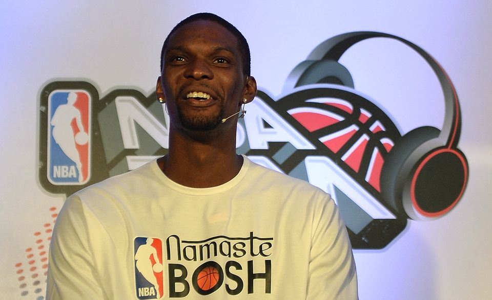 Miami Heat's forward player Chris Bosh speaks during a news conference in Mumbai on July 17, 2013. Bosh will conduct a one da