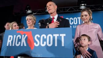 UNITED STATES - NOVEMBER 6: Florida Gov. Rick Scott (R), addresses his election night party in Naples, Fla., where he declared victory in the Florida Senate race with incumbent Sen. Bill Nelson, D-Fla., on November 6, 2018. His wife Ann, daughters, Allison, right, and Jordan, far left, also appear. (Photo By Tom Williams/CQ Roll Call)