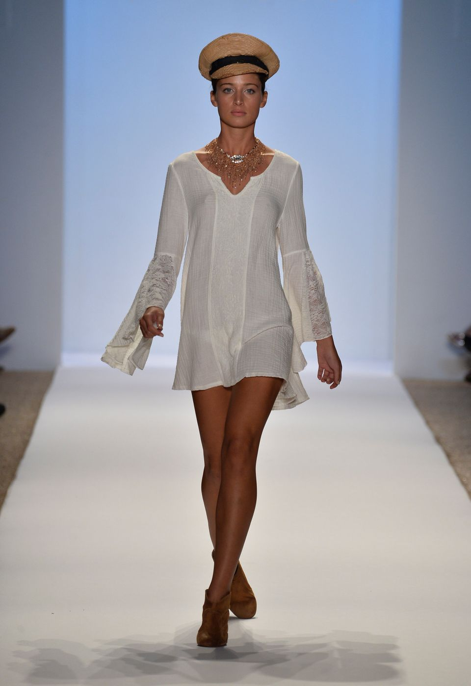 MIAMI, FL - JULY 21:  A model walks the runway at the L*Space By Monica Wise show during Mercedes-Benz Fashion Week Swim 2014