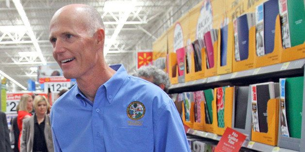 Florida Gov. Rick Scott shops on first day of the back-to-school tax holiday at a Wal-Mart in Orlando, Florida, Friday, Augus