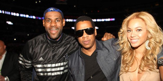 LOS ANGELES, CA - FEBRUARY 20:  LeBron James #6 of the Eastern Conference talks with Rapper Jay-Z and Singer Beyonce during t