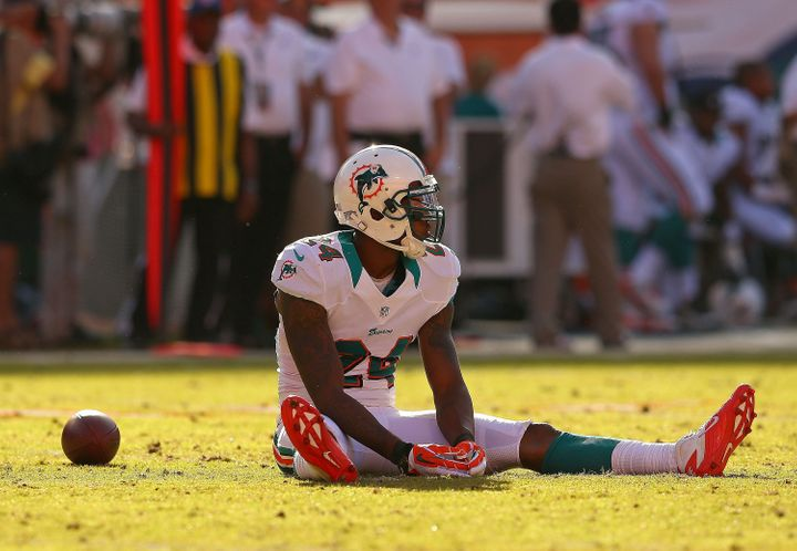 MIAMI GARDENS, FL - NOVEMBER 11:  Sean Smith #24 of the Miami Dolphins rects to missing an interception during a game against