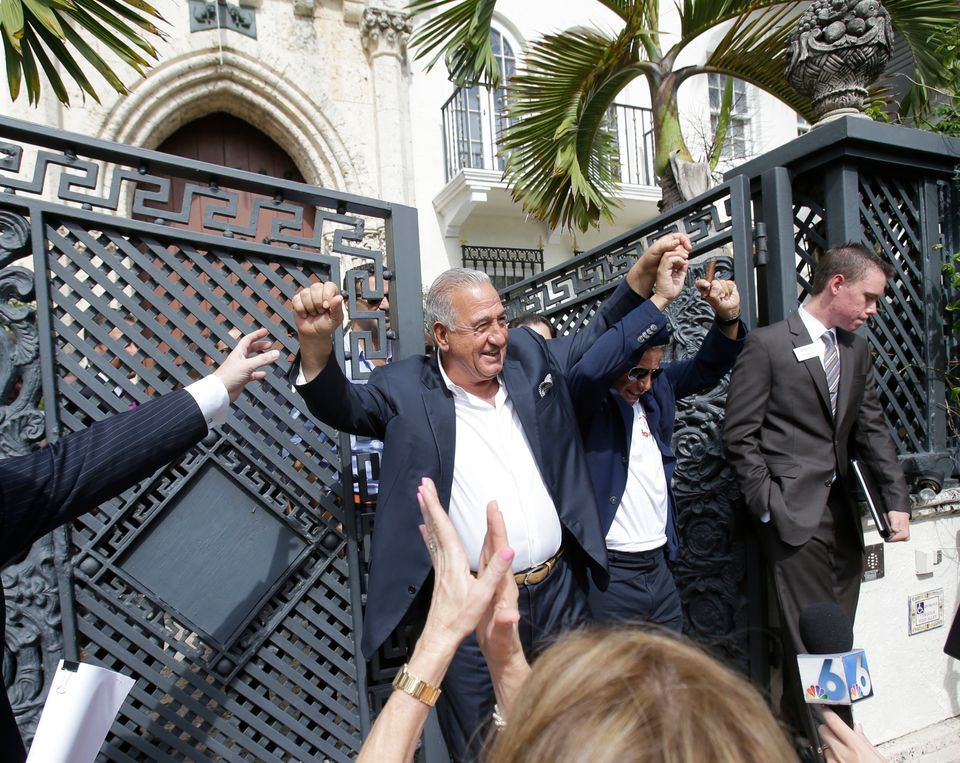 Joe Nakash, center, and Eli Gindi, second from right, with VM South Beach LLC, emerge from the South Beach mansion that once