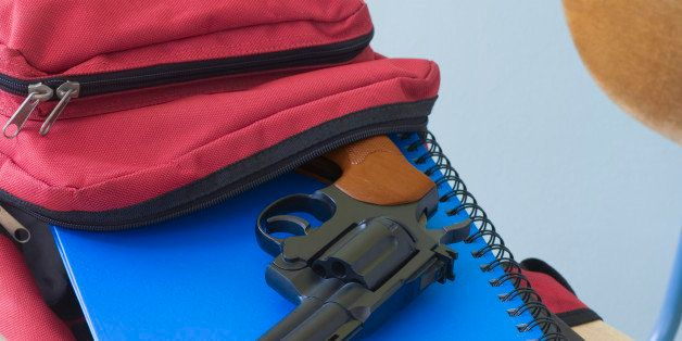 Backpack, notebooks, and handgun