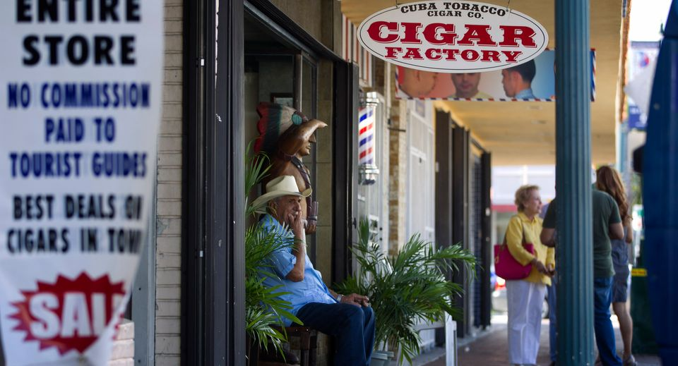 Don Pedro Bello sits in front of his cigar factory, Cuba Tobacco Company, in Miami's Little Havana section, Tuesday, Oct. 16,