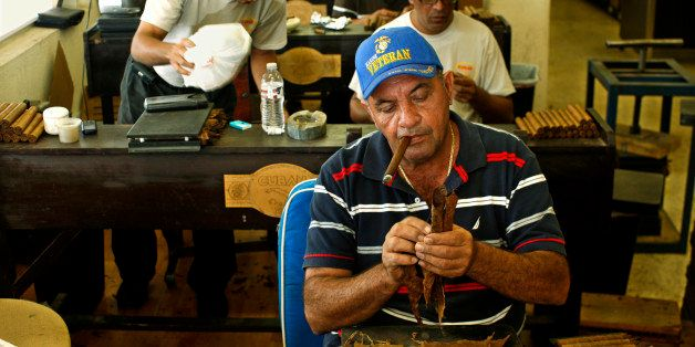 Cigar Roller Smoking a Cigar, Cuban Crafters, Miami (Photo by Hoberman Collection/UIG via Getty Images)