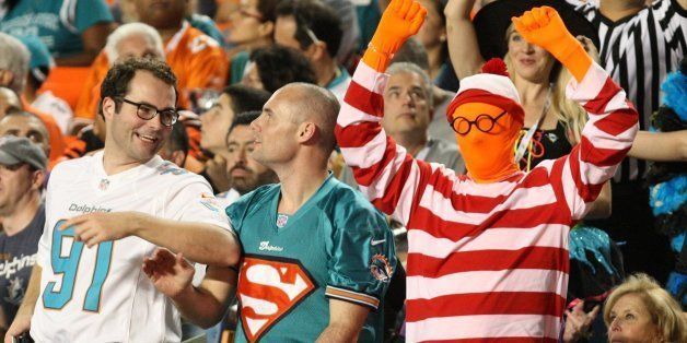 Miami Dolphins fans celebrate Halloween as the Dolphins play host to the Cincinnati Bengals at Sun Life Stadium in Miami Gard