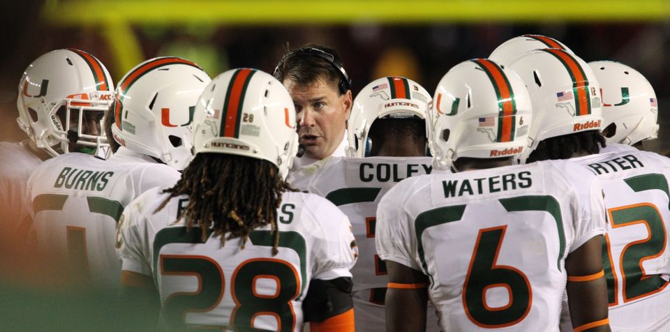 Miami coach Al Golden gathers his squad between plays in the second quarter against Florida State during an NCAA college foot