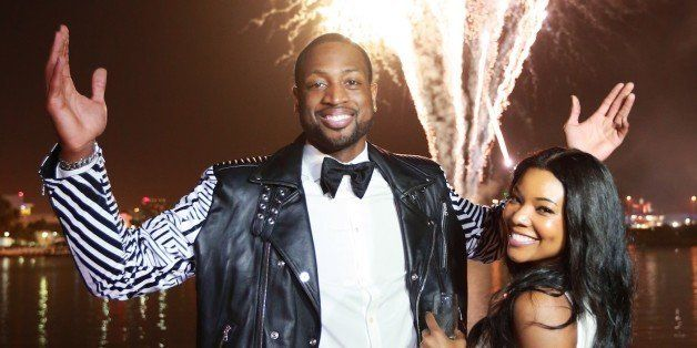 MIAMI BEACH, FL - JANUARY 11:  (EXCLUSIVE COVERAGE) Dwyane Wade and Gabrielle Union enjoy the fireworks display at Dwyane Wad