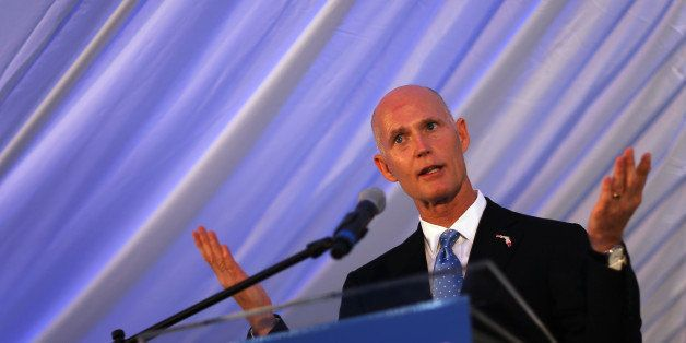 MIAMI, FL - AUGUST 29:  Florida Gov. Rick Scott speaks at the grand opening of the main North American training campus for Bo