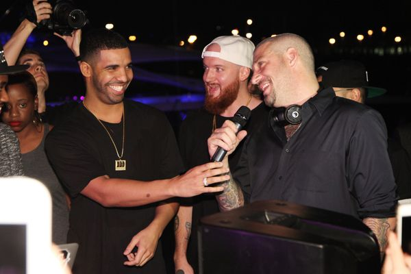 Drake performed a surprise DJ set to celebrate the launch of Muzik smart headphones at a home on Palm Island.
