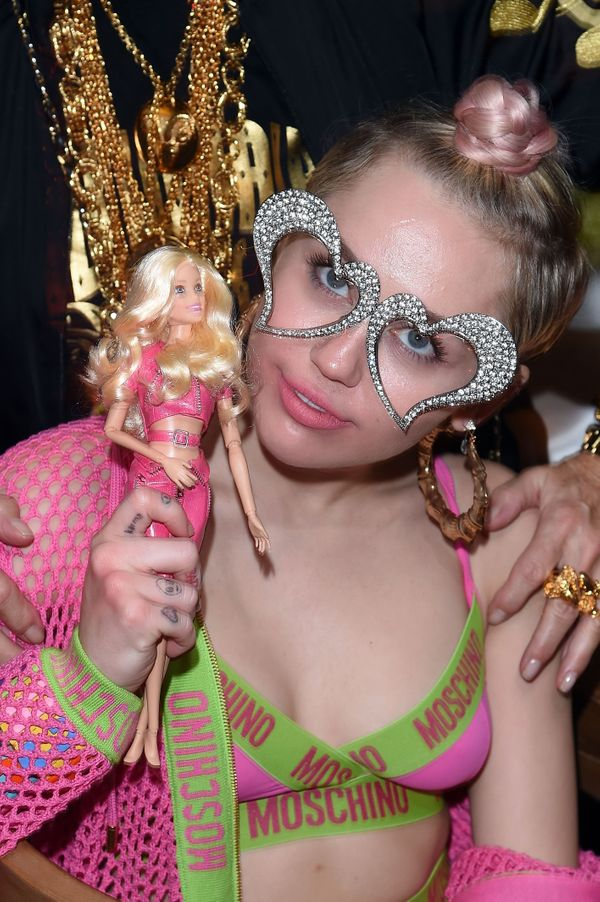 Miley Cyrus was photographed at the Jeremy Scott & Moschino Party with Barbie.