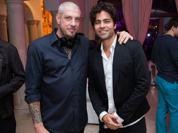 Adrian Grenier helped Muzik CEO Jason Hardi launch the world's first smart headphones at a bash on Palm Island.